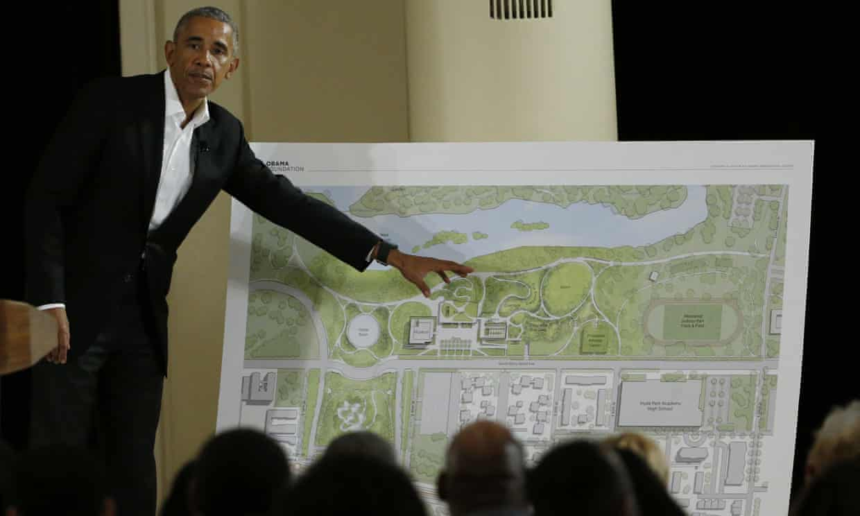 Barack Obama points to a rendering of his presidential library, in Chicago, where ground will be broken this week. Photograph: Nam Y Huh/AP