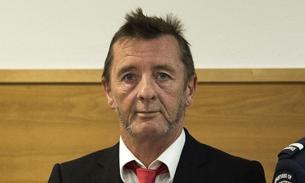 Phil Rudd stands in the dock at the district court in Tauranga, New Zealand on Tuesday. The veteran rocker made a surprise guilty plea on charges of threatening to kill and drug possession.