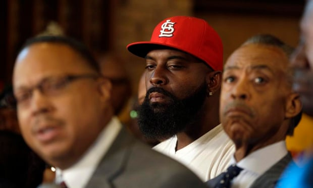 Michael Brown Sr, center, listens alongside the Rev Al Sharpton, right, and Brown family attorney Anthony Gray.
