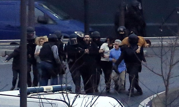 Members of the French police special forces evacuate hostages after launching the assault at a kosher grocery store in Porte de Vincennes, eastern Paris.