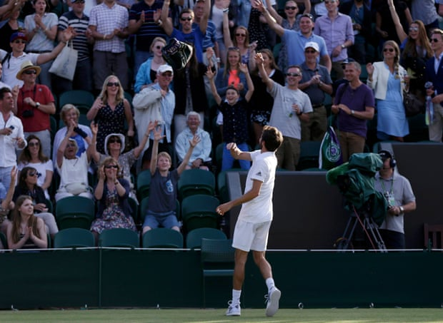 Gilles Simon throws his towel into the crowd after winning his match against Tomas Berdych.