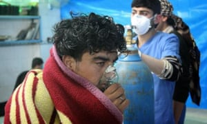 A Syrian man receives treatment at the Sarmin field hospital following a suspected chlorine gas attack by Assad forces in Idlib, Syria, in April 2015.