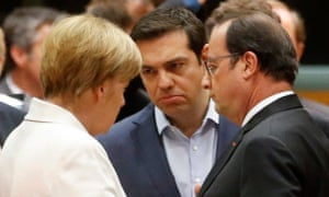 Angela Merkel, Alexis Tsipras and François Hollande talk at the eurozone leaders summit in Brussels.