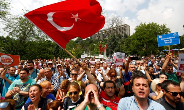 Red flag … Turkish people at a protest in Istanbul.