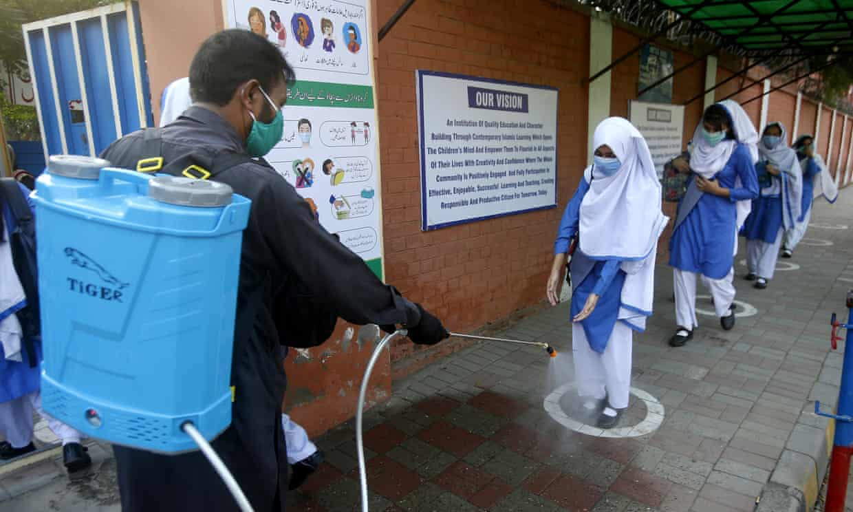 'Many poorer countries already face dangerous amounts of indebtedness, with 64 countries currently paying more on debt servicing than on healthcare.' A student has her shoes disinfected at a school in Lahore, Pakistan. Photograph: KM Chaudary/AP