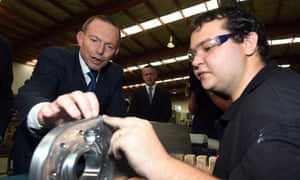 Tony Abbott examines an aircraft part during a visit to Ferra Engineering in Brisbane on Wednesday morning. The firm manufactures parts for Boeing aircrafts as well as for Australian Air Force F-18 Hornets jet fighters.