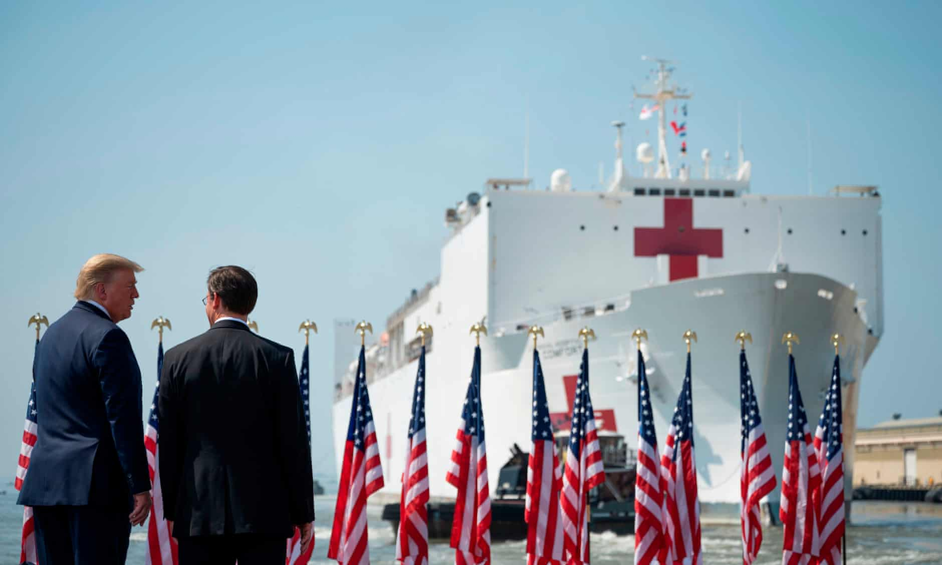 Defense Secretary Mark Esper and President Donald Trump watch as the hospital ship USNS Comfort leaves Naval Base Norfolk, in Virginia, for New York. Photograph: Jim Watson/AFP via Getty Images