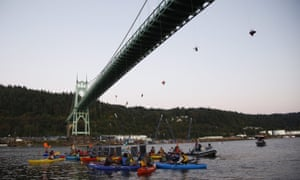 Activists hang under the St Johns Bridge in Portland, Oregon, in an attempt to block the Shell-leased icebreaker MSV Fennica.