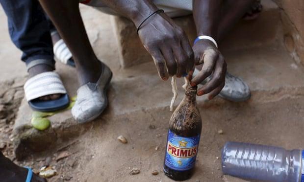 A protester prepares a petrol bomb in Bujumbura