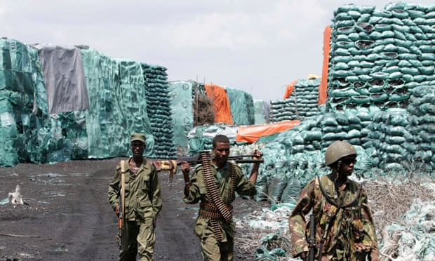 Kenya Defence Forces at a charcoal depository formerly under the control of al-Shabaab militants. Photograph: Noor Khamis/Reuters
