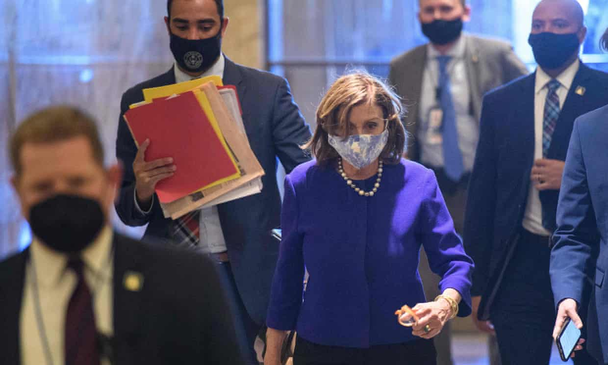 The House speaker, Nancy Pelosi, arrives at the US Capitol on Monday. Moderate and progressive Democrats are split over the size of Joe Biden's social spending package. Photograph: Mandel Ngan/AFP/Getty Images