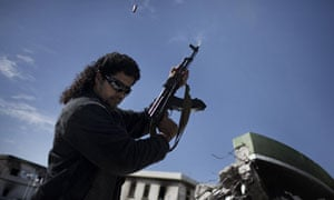 A Libyan armed man shoots in the air
