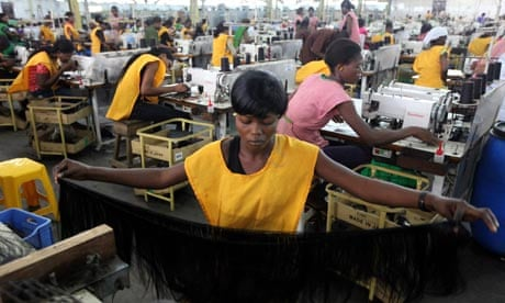 Women at work in a factory in Nigeria's commercial capital, Lagos. Photograph: Akintunde Akinleye/Reuters