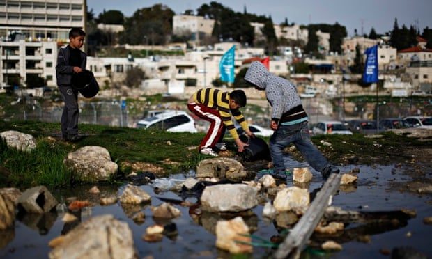 Palestinian children collect water in the Sheikh Jarrah neighbourhood in East Jerusalem.