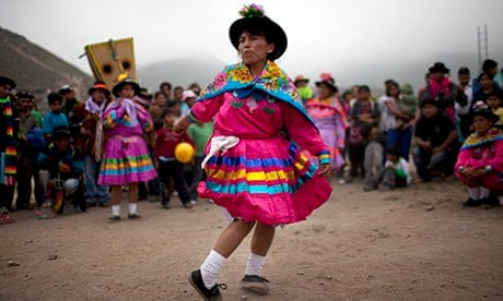 South American Tribal Women An indigenous woman performs a