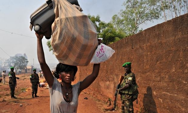 A woman in Bangui, CAR, flees after an attack by anti-balaka militia