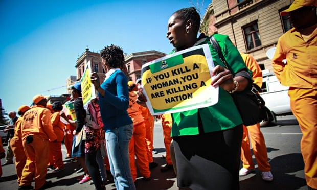 Women's rights activists outside the high court in Pretoria, South Africa, during the trial of Oscar Pistorius in September 2014.