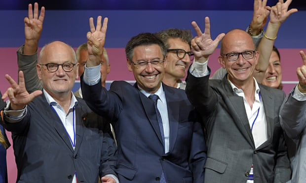 Josep Maria Bartomeu, centre, celebrates after winning the elections for the Barcelona presidency, b