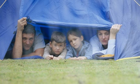 Family in a tent looking at the rain