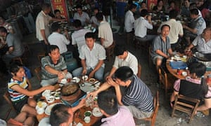 Chinese diners tuck into dog-meat hotpot in a restaurant in Yulin, Guangxi province