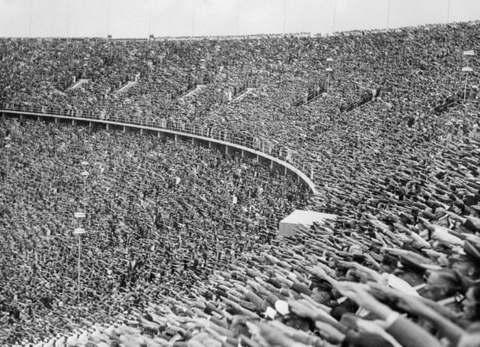 The crowd at the 1936 Olympic Games in Berlin raise their hands in the Nazi salute in tribute to Hitler's arrival at the stadium.