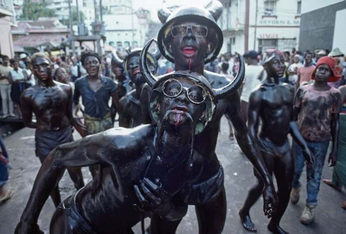 Carnival revelers  adorned with dead snakes in Grenada 1984