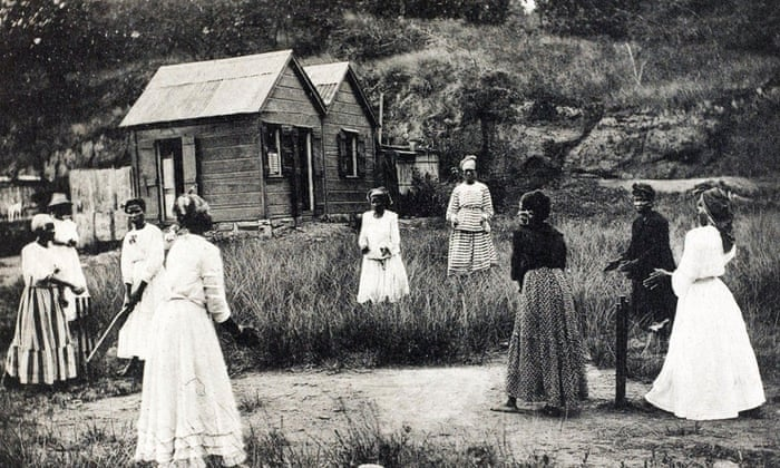 Women playing cricket on a cleared piece of scrubland in St Lucia circa 1905