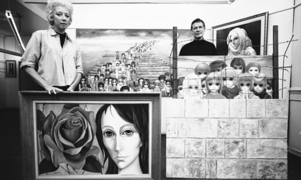 Margaret and Walter pose with a selection of paintings in 1965.