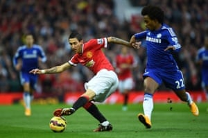 Angel Di Maria of Manchester United turns away from Willian of Chelsea.