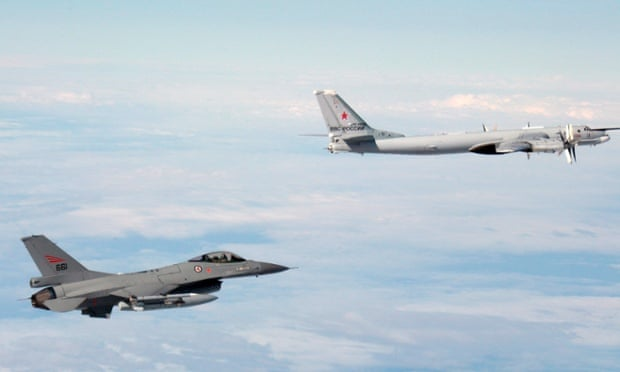 A Norwegian F-16 follows a Russian air force Tupolev Tu-95 in a photograph released by the Norwegian air force.