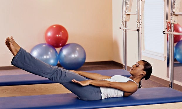 Woman practicing pilates
