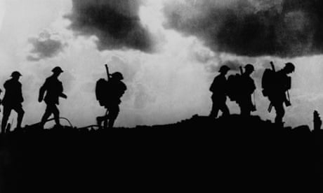 British troops in silhouette march towards trenches near Ypres at the Western Front during the First World War. Photograph: Hulton-Deutsch Collection/Corbis