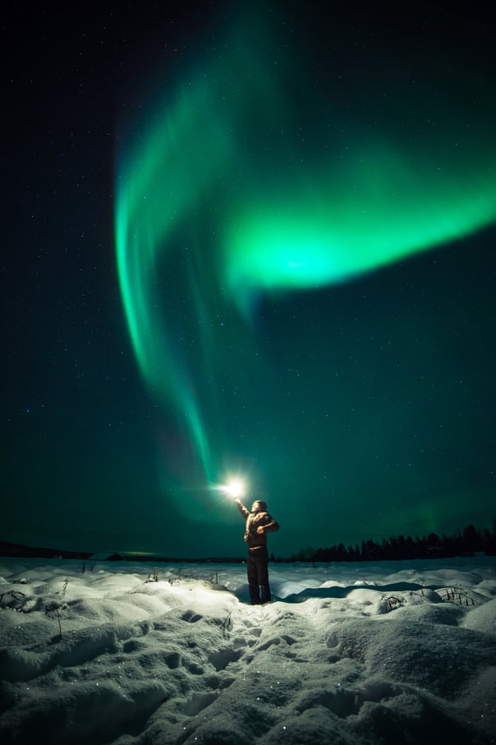 "A young wizard casts the ""lumos"" spell causing the Northern Lights to appear in the Lappish firmament."