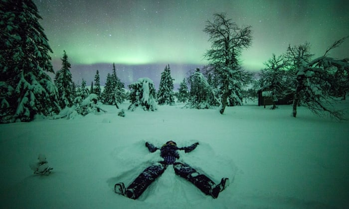 "Creating a ""snow angel"" (made by lying in the snow and waving your arms and legs)  takes on an particularly magical quality with the Northern Lights glowing on the horizon."