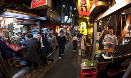 In Tokyo\'s sake bars the mood turns grim as weary workers brace for more pain...