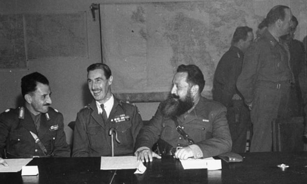 Lt Gen Ronald Scobie with two other military men at a desk. On 5 December 1944, imposed martial law and ordered the aerial bombing of the working-class Metz quarter of Athens.