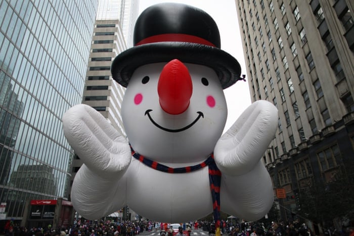New York, US A snowman balloon make its way down JFK Boulevard during the 95th annual Thanksgiving Day Parade
