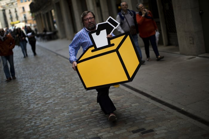 Girona, Spain Businessman Emilio Busquets carries a drawing of a ballot box to decorate his shop before a symbolic vote on independence of Catalonia from Spain