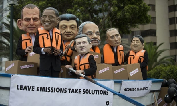 Activists on the sidelines of the UN climate talks in Lima, Peru, dress as world leaders and urge action on carbon emissions.