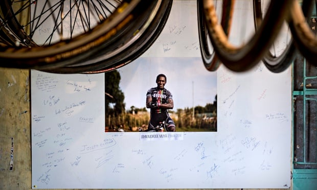 The Kenyan Riders have made a tribute to their team leader John Njoroge, who died in an accident in August. Photograph: Sven Torfinn/for the Guardian .
