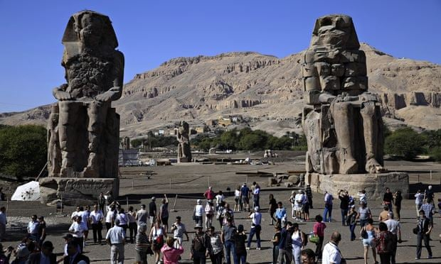 The twin Memnon colossi show Amenhotep III seated. Photograph: Hassan Ammar/AP