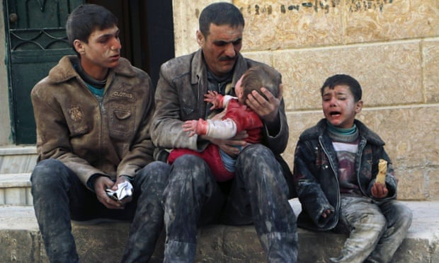 A man holds a baby saved from under the rubble after an air strike by regime forces.