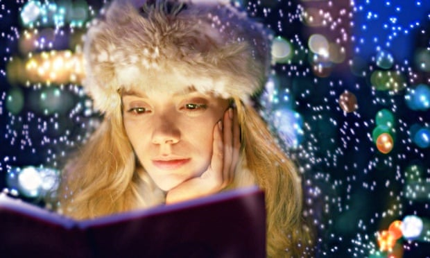 woman reading winter lights