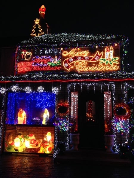 A small ex-local authority house in Dublin, Ireland, lit up for Christmas.