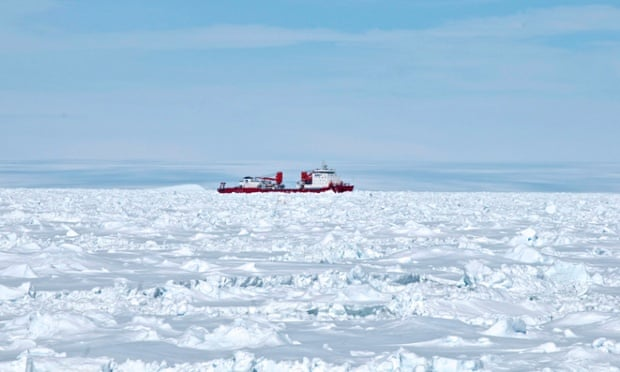 The Chinese Antarctic vessel Xue Long seen from the bridge of the Aurora Australis ship off Antarctica, both in the frozen waters to help rescue the nearby Russian research ship.