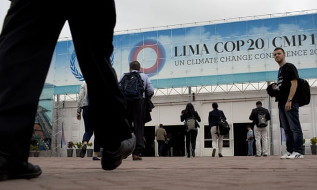 People arrive to the Climate Change Conference in Lima, Peru, Monday, Dec. 1, 2014.