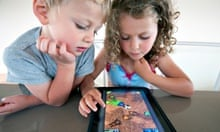 Children playing a computer game on an iPad tablet