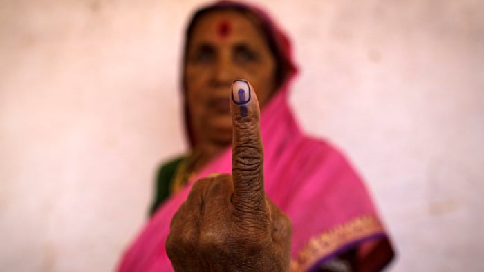 Indian voters wear Mysore ink mark as symbol of democratic privilege