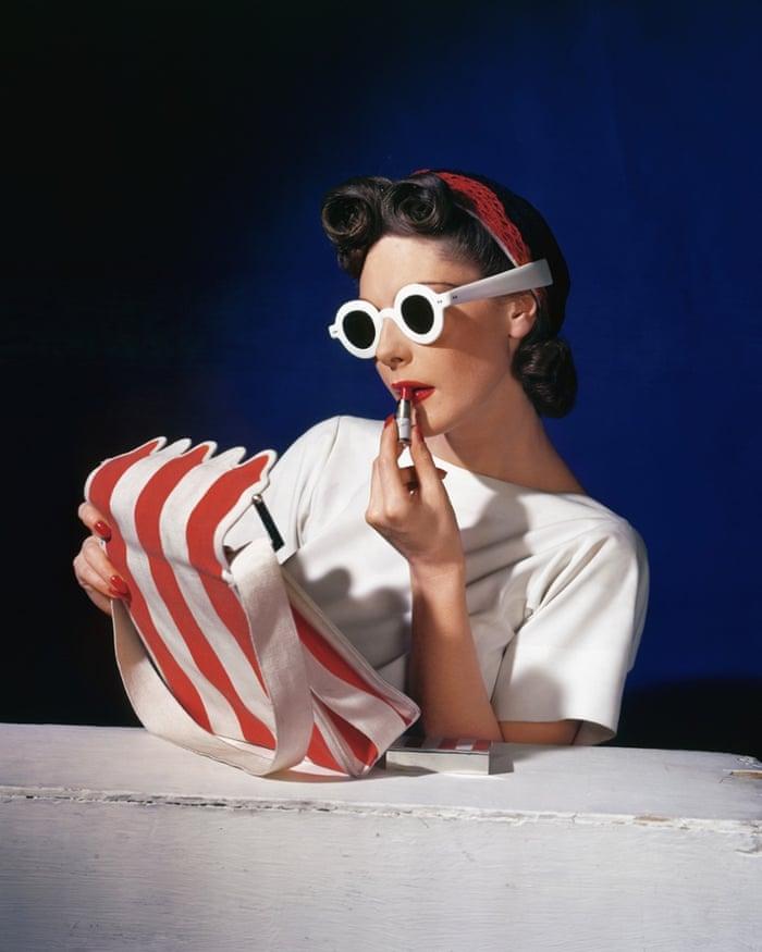 Model Muriel Maxwell putting on lipstick.