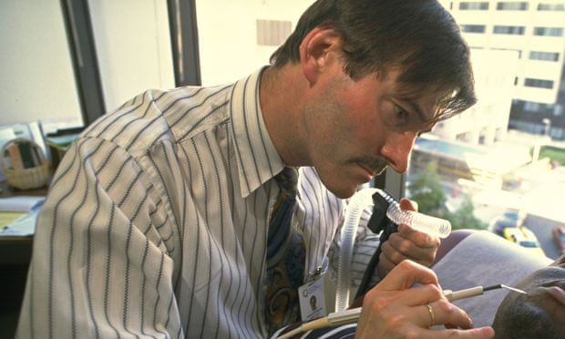 Charles Farthing treating a patient in Los Angeles in 1997. - Charles-Farthing-treating-008